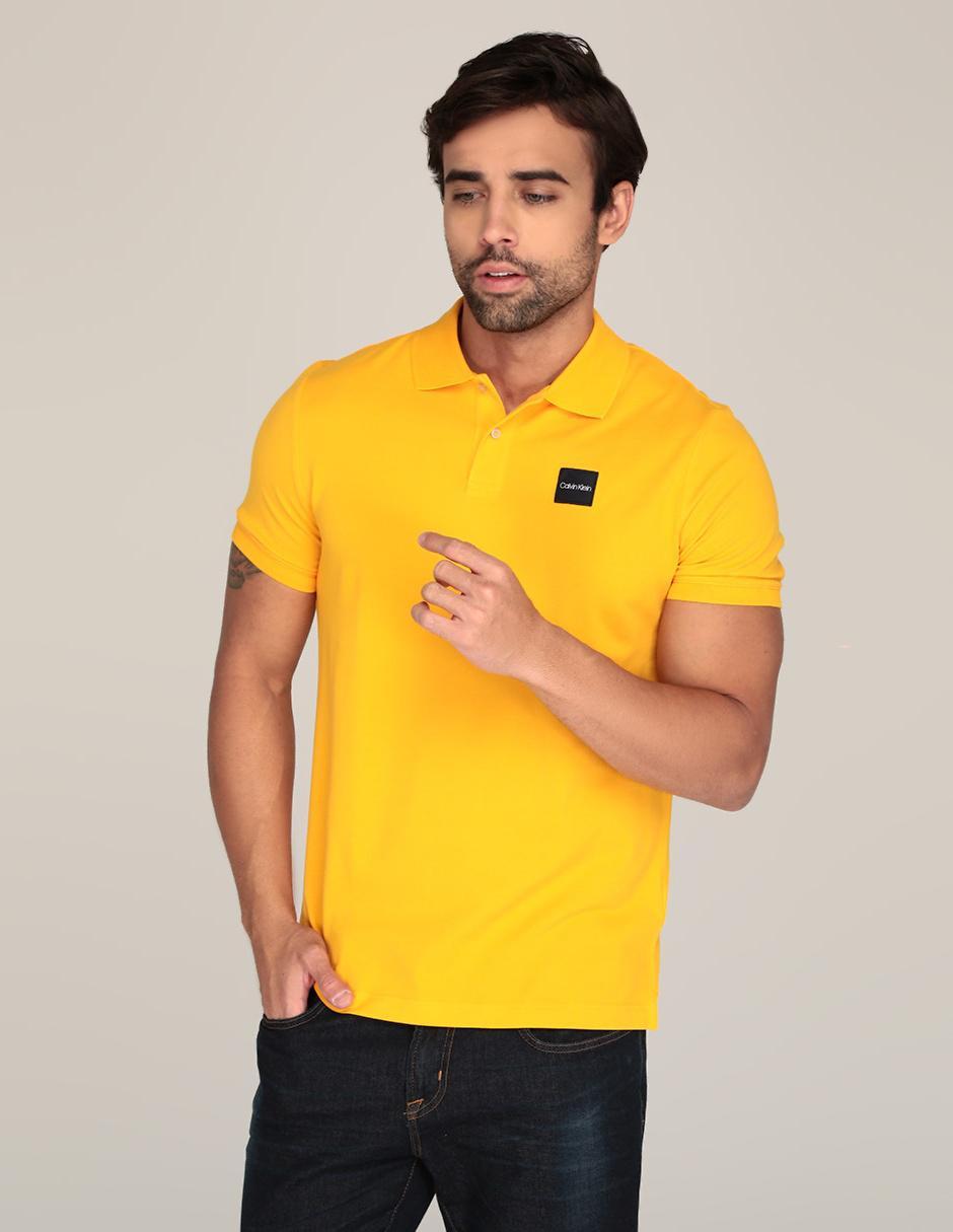 b0c7257980996 Playera polo Calvin Klein corte regular fit amarilla